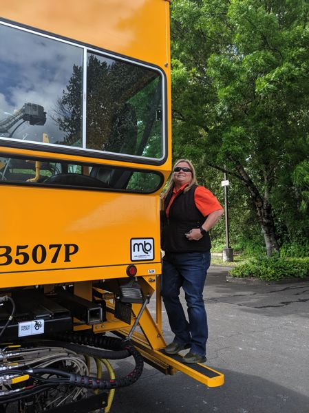 PMG PHOTO: JOSEPH GALLIVAN  - Kellie Dimmitt, a striper for Washington County, on her striping truck at the Oregon Tradeswomens Fair on Friday May 17, 2019. When its dry she either drives the striper truck or sits in a glass cab at the back, operating the paint guns and checking the work as it rolls away behind them.