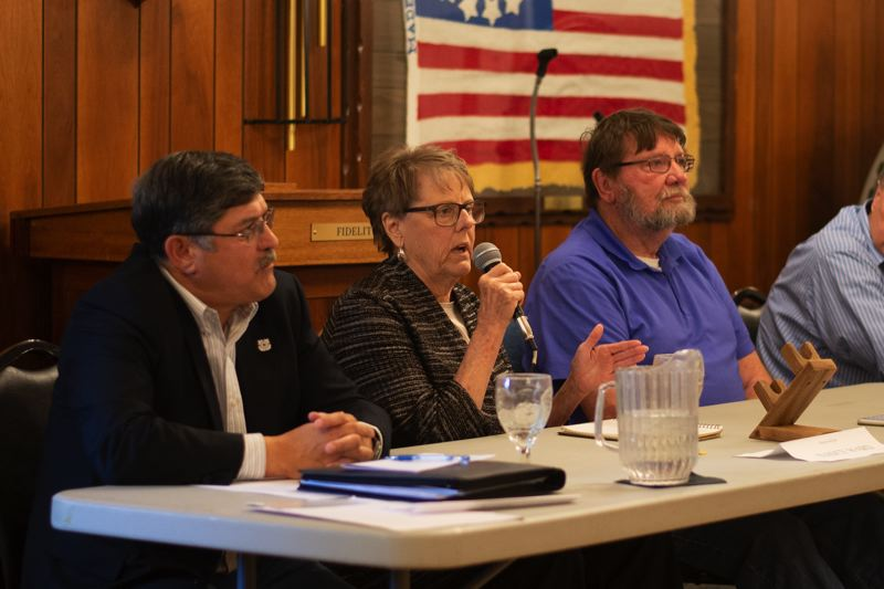 PMG PHOTO: ANNA DEL SAVIO - Nancy Ward, center, won the race for Port of Columbia County commissioner against Stephen Hanson, right, and incumbent Patrick Trapp, left.