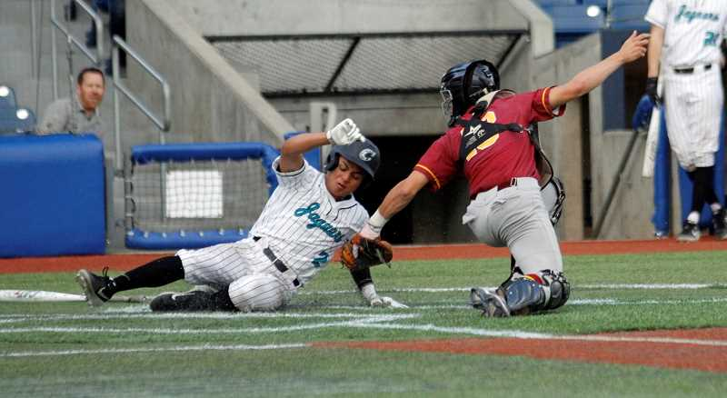 PMG PHOTO: WADE EVANSON - Century's Gene Quitugua slides into home during the Jaguars' playoff game versus Central Catholic Wednesday, May 29, at Ron Tonkin Field in Hillsboro.