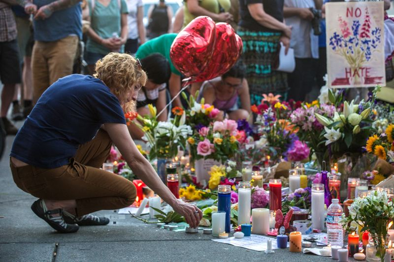 PMG FILE PHOTO - Mourners lay candles and flowers during a vigil for stabbing victims Taliesin Namkai-Meche and Ricky Best at the Hollywood Transit Center. Namkai-Meche's family sued TriMet and Portland police for wrongful death, seeking more than $10 million in damages.