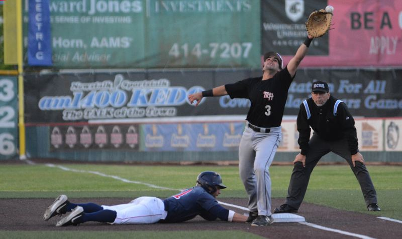 PMG PHOTO: DAVID BALL - Mt. Hood first baseman Kevin Miser reaches up high to try and reach a pick-off throw, while Lower Columbias DeShawn Johnson dives back to the bag.