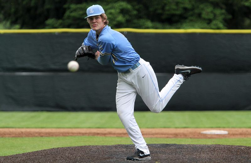 PMG PHOTO: MILES VANCE - Lakeridge junior Cooper Justice delivers during his team's 7-0 win over Tigard in the second round of the Class 6A state baseball playoffs at Lakeridge High School on Wednesday, May 22.