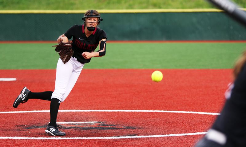 PMG PHOTO: DAN BROOD - Tualatin junior Tia Ridings fires in a pitch during the seventh inning of the Timberwolves' 2-0 state playoff victory over Franklin.