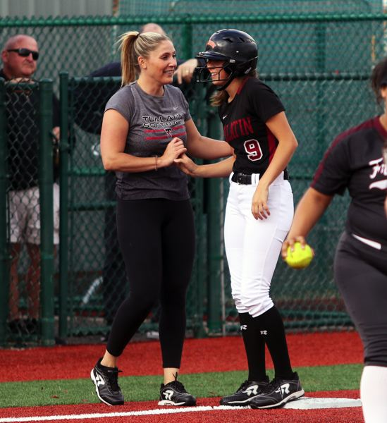 PMG PHOTO: DAN BROOD - Tualatin junior Sydney Wagner (right) is congratulated by head coach Jenna Wilson following her RBI triple in the Wolves' 2-0 playoff win over Franklin.
