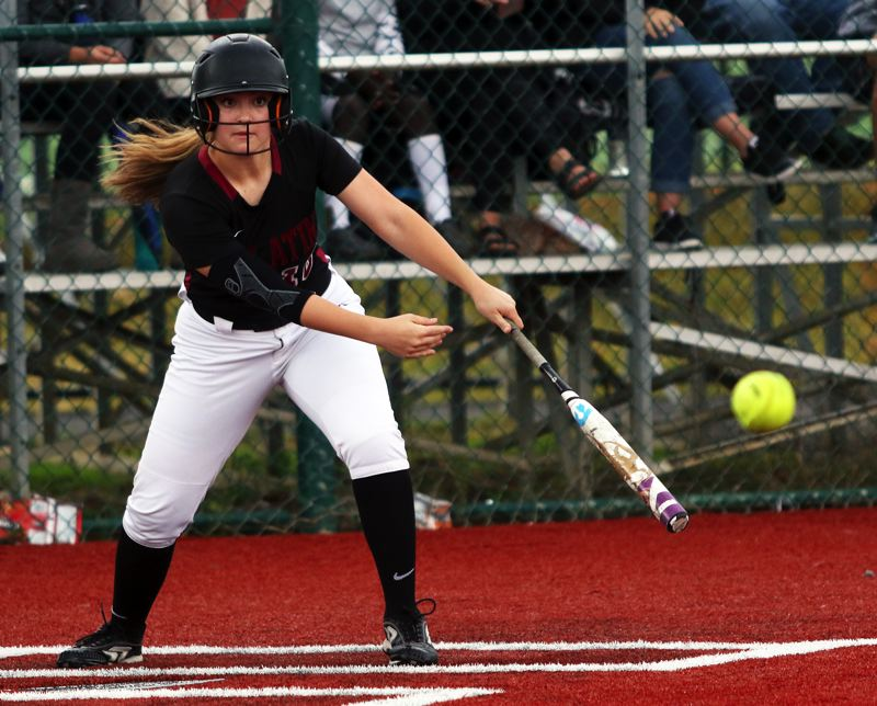 PMG PHOTO: DAN BROOD - Tualatin High School freshman Leanna Rosenbaum puts the ball in play during the Wolves' 2-0 state playoff win over Franklin.