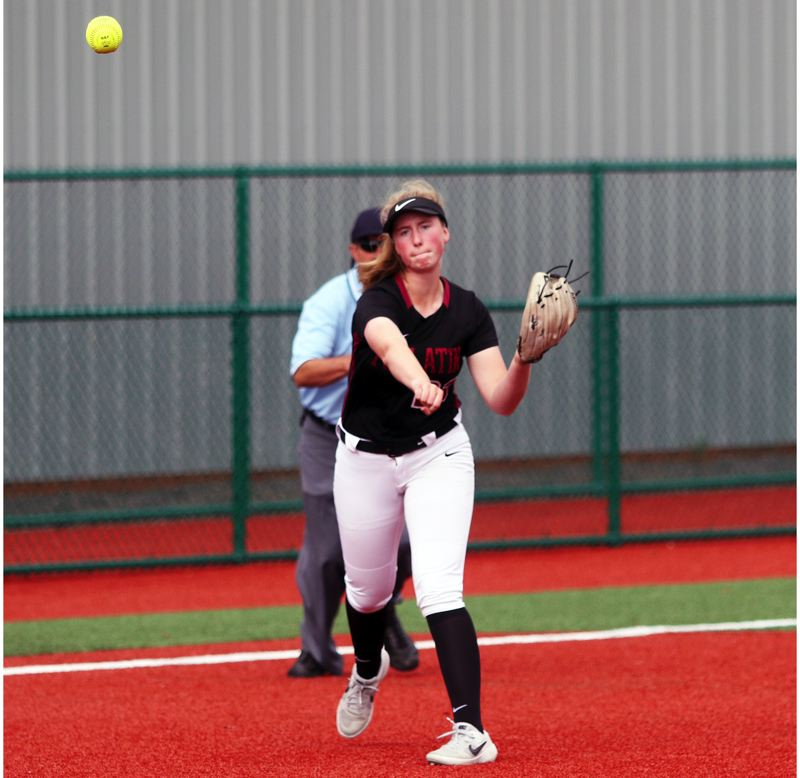 PMG PHOTO: DAN BROOD - Tualatin freshman third baseman Ella Hoyle makes a throw to first base during the Wolves' 2-0 state playoff win over Franklin.