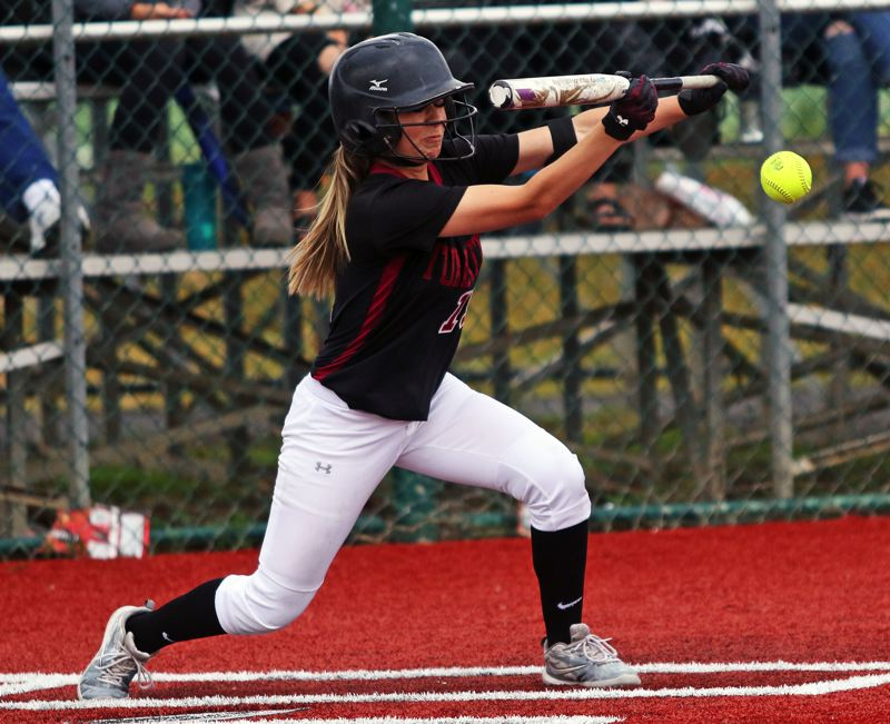 PMG PHOTO: DAN BROOD - Tualatin High School senior Andrea Gomez puts down a bunt during the Timberwolves' 2-0 state playoff win over Franklin.