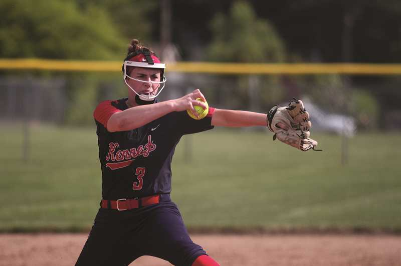 PMG PHOTO: PHIL HAWKINS - Kennedy junior Grace Schaecher struck out nine and held Oakland to a pair of runs in the fourth inning in the Trojans 12-2 win over Oakland on May 22.