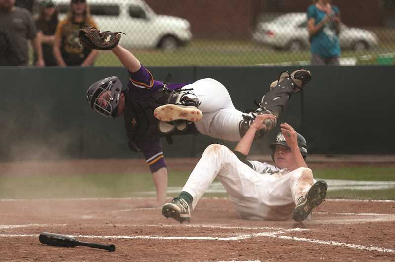 PMG PHOTO: PHIL HAWKINS - North Marion junior Noah Wierstra was thrown out at the plate in the fourth inning in a crucial play that prevented the Huskies from scoring the go-ahead run in the team's 2-1 loss in 10 innings to the Astoria Fishermen in the first round of the 4A state playoffs on May 22.