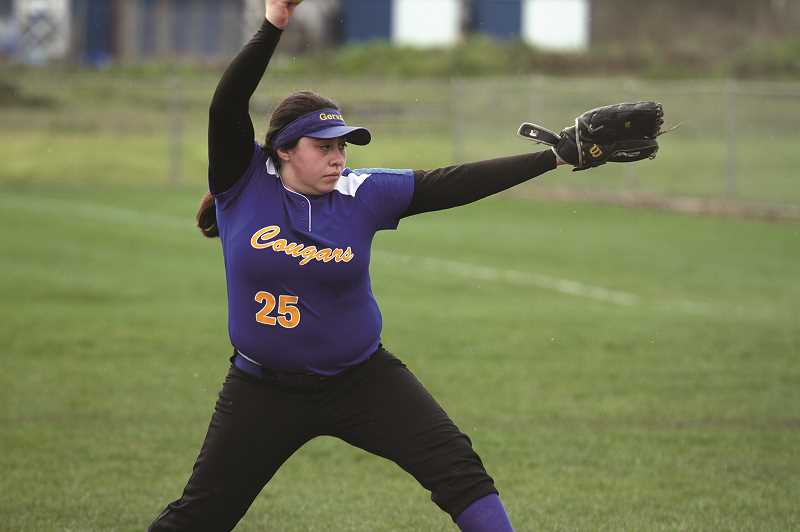 PMG FILE PHOTO: PHIL HAWKINS - Gervais senior Veronica Esquivel struck out 10 batters and gave up two earned runs and five hits in the Cougars' 8-1 loss to the Waldport Irish in the first round of the 2A/1A softball playoffs.