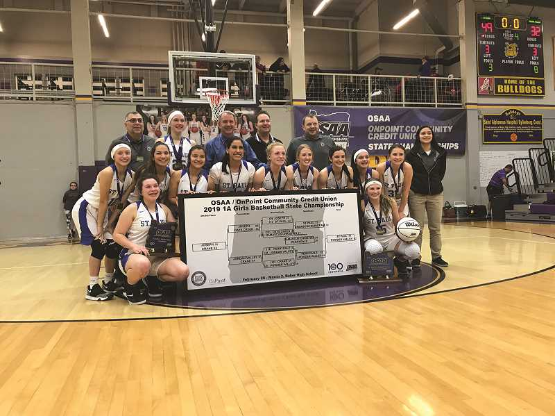 COURTESY PHOTO - The St. Paul High School girls basketball team, 1A state champs, will serve as grand marshals, with the state champion volleyball team, for the St. Paul Rodeo parade on July 4. The team was 30-0.