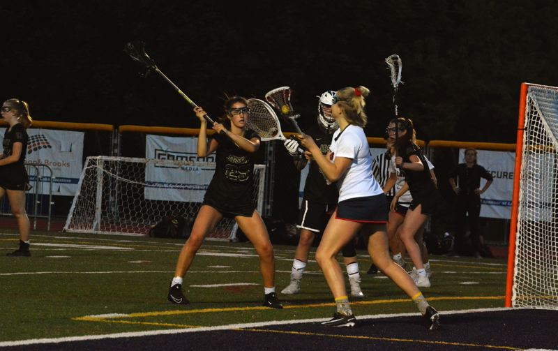 TIMES PHOTO: MATT SINGLEDECKER - Jesuit defender Ella Gray applies pressure to a Lake Oswego player in the title game.