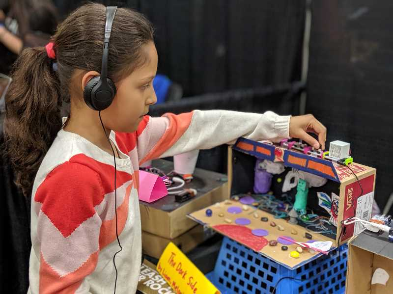 PMG PHOTO: COURTNEY VAUGHN - Melanie Martinez, a Vose Elementary School student, controls sounds on a circuit board for her group project, The Dark Side. Martinez and other students in the Beaverton School District demonstrated projects during the iX19 Innovation Expo held May 16.
