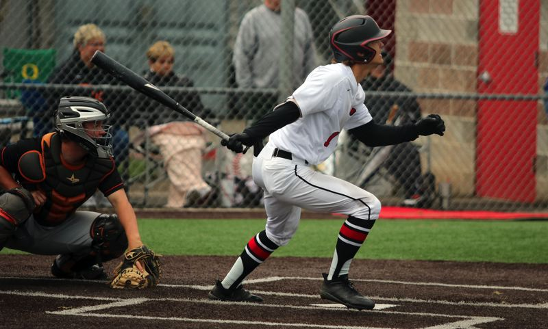 PMG PHOTO: JIM BESEDA - Clackamas' Grant Schoen watches the ball sail toward the the left-field fence for a two-run homer in the fourth inning of Friday's 6-2 win over Roseburg in the OSAA 6A baseball quarterfinals.