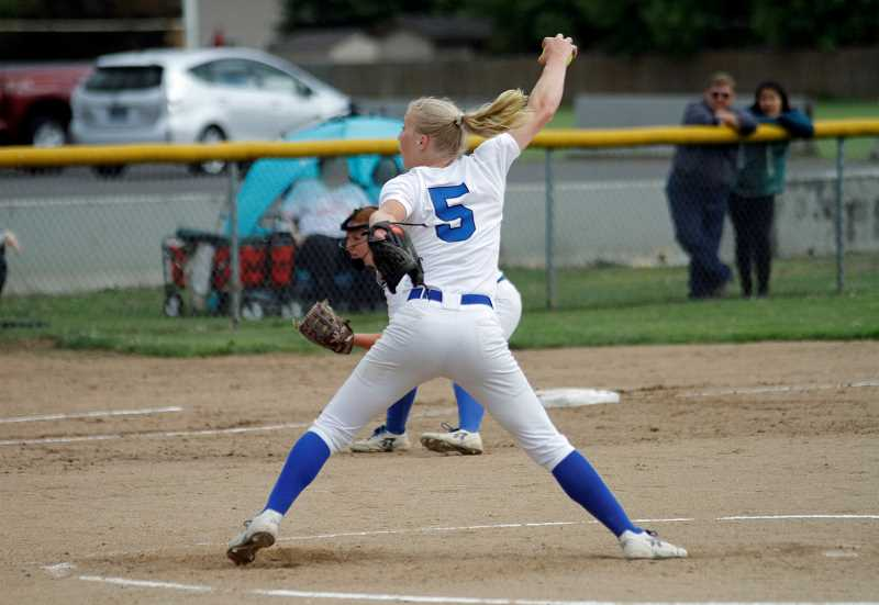 PMG PHOTO: WADE EVANSON - Hillsboro's McKenzie Staub throws a pitch during the Spartans' game against Lebanon in the playoffs' first round Wednesday, May 22, at Hillsboro High School.