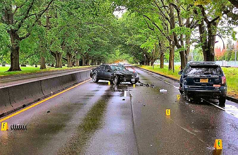 COURTESY PORTLAND POLICE BUREAU - Officers charged the driver of the spun-around Cadillac with being too intoxicated to drive, after he failed to maneuver around two police cars parked beside the road with emergency lights flashing.
