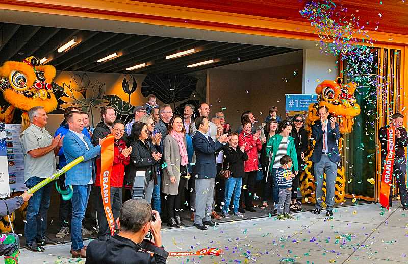 DAVID F. ASHTON - After the scissors snip, the dedication ribbon goes flying and confetti showers the courtyard at the brand new 72Foster housing project in the Foster-Powell neighborhood.