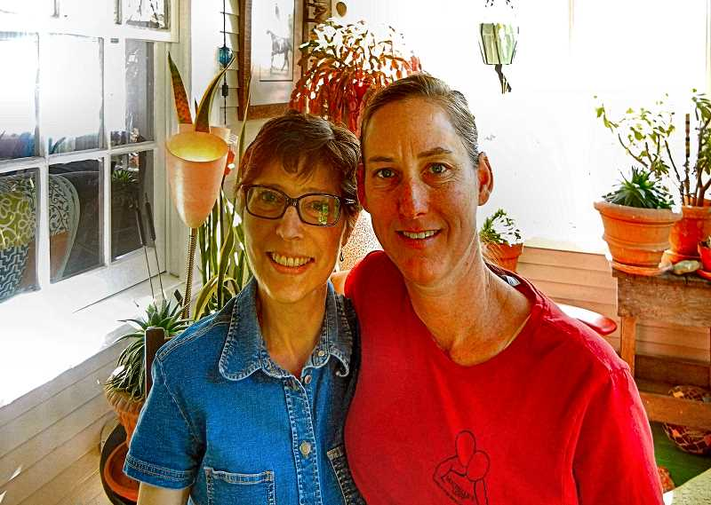ELIZABETH USSHER GROFF - Woodstock resident Mary Rower, left, and Mrs. Andy McCandless, the founder of Michelles Love were photographed on the morning before the nonprofit volunteer organization did a deep cleaning of the Rower house.
