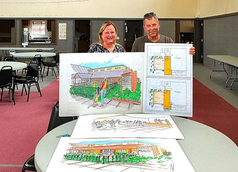 DAVID F. ASHTON - Kathy and Chris Maas show plans that Immanuel Lutheran Church is making to upgrade its campus.