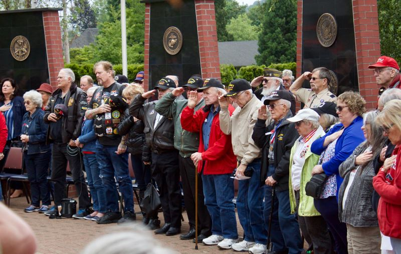 PMG PHOTO: CHRISTOPHER KEIZUR - About 100 people gathered Monday morning, May 27, for a Memorial Day ceremony.