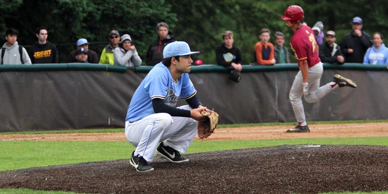 PMG PHOTO: MILES VANCE - Lakeridge pitcher Colin Hardy looks on as Central Catholic's Christian Cooney rounds third base after hitting a three-run homer in the seventh inning of the Pacers' 6-3 home loss in the Class 6A state quarterfinals onn Friday, May 24.