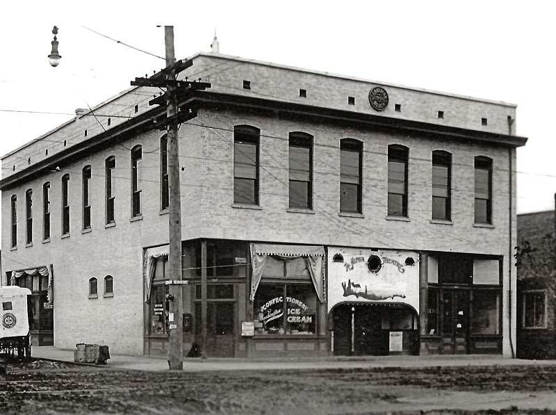 COURTESY OF SMILE HISTORY COMMITTEE - Heres a photo of the Strahlman Building, built in 1907 on the northeast corner of 13th Avenue and S.E. Spokane Street - in which was located Sellwoods first movie theater, The Alpha; and Strahlmans confectionary. Until the building was torn down in 1942, the upstairs of Strahlman Hall was a favorite location for meetings, fancy dances and balls, and a variety of community events. The space today is a parking lot.