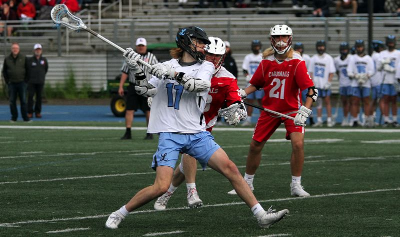 PMG PHOTO: MILES VANCE - Lakeridge junior Luke Lamont cranks up a shot during his team's 8-5 win over Lincoln in the OHSLA state quarterfinals at Lakeridge High School on Friday, May 24.