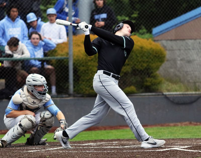 PMG PHOTO: DAN BROOD - Tigard High School senior Fletcher Ahl takes a swing during the Tigers' state playoff game at Lakeridge on May 22.