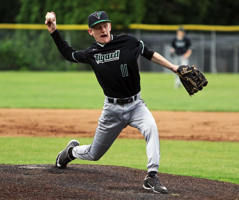 PMG PHOTO: DAN BROOD - Tigard High School senior Bobby Carter gets ready to fire in a pitch during the Tigers' Class 6A state playoff game at Lakeridge.