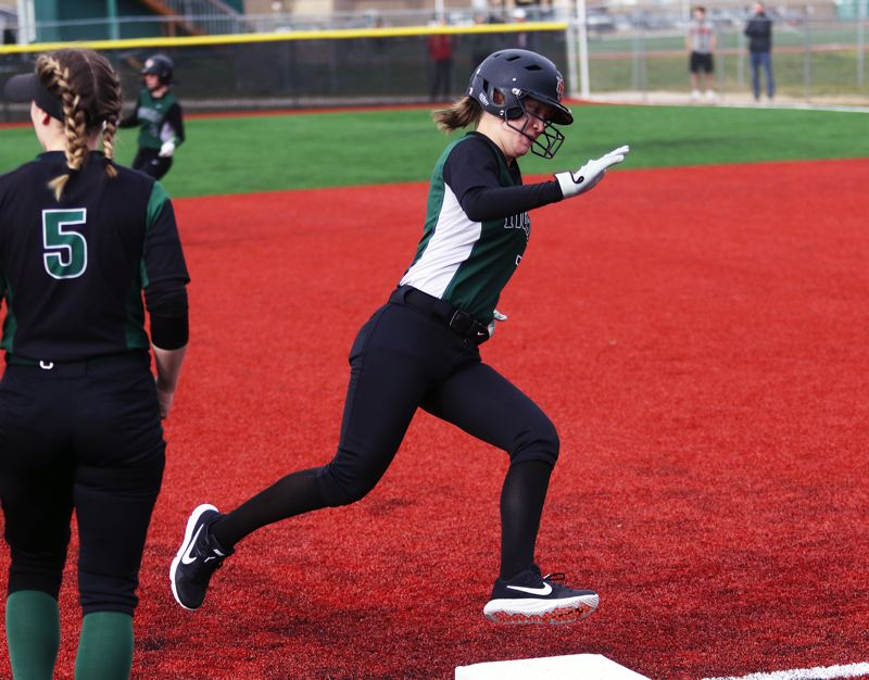 PMG PHOTO: DAN BROOD - Tigard High School junior Lexi Klum, shown here in a game earlier this season, had a home run and a triple in the Tigers' state playoff loss at McMinnville.