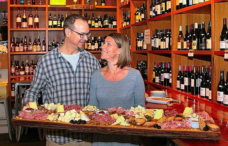 DAVID F. ASHTON - The hosts of Mays SMBA Spring Meet, Greet & Eat - Emily and Travis Motter, at the Portland Bottle Shop - display the festal board they prepared for the business associations members - loaded with cheese and charcuterie.