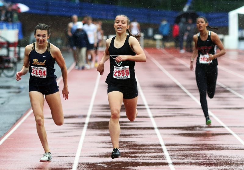 PMG PHOTO: DAN BROOD - Tigard High School freshman Riley Patera (center) ran to third place in the 400-meter dash at the Class 6A state track and field championships.