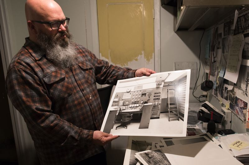 PMG PHOTO: JAIME VALDEZ - Architect and photographer Harley Cowan shows B&W images he took of the Hanford site in Washington State.