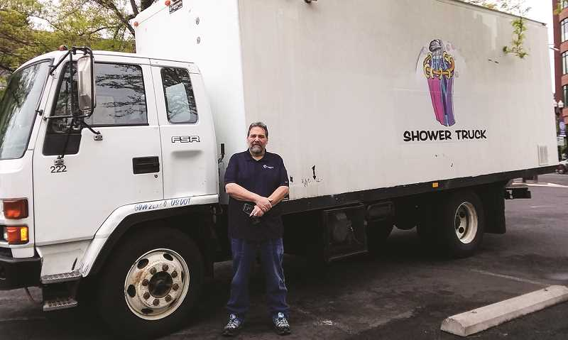 PHOTO SUBMITTED BY MIKE WILSON  - Greg Sanders, executive director of Redemption House Ministries, displays the new shower truck they recently acquired.