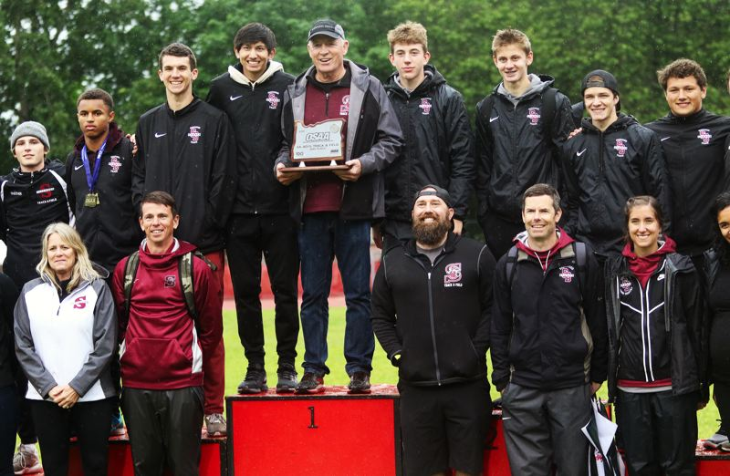 PMG PHOTO: DAN BROOD - The Sherwood High School boys track and field team won the second place trophy at the Class 6A state championships.