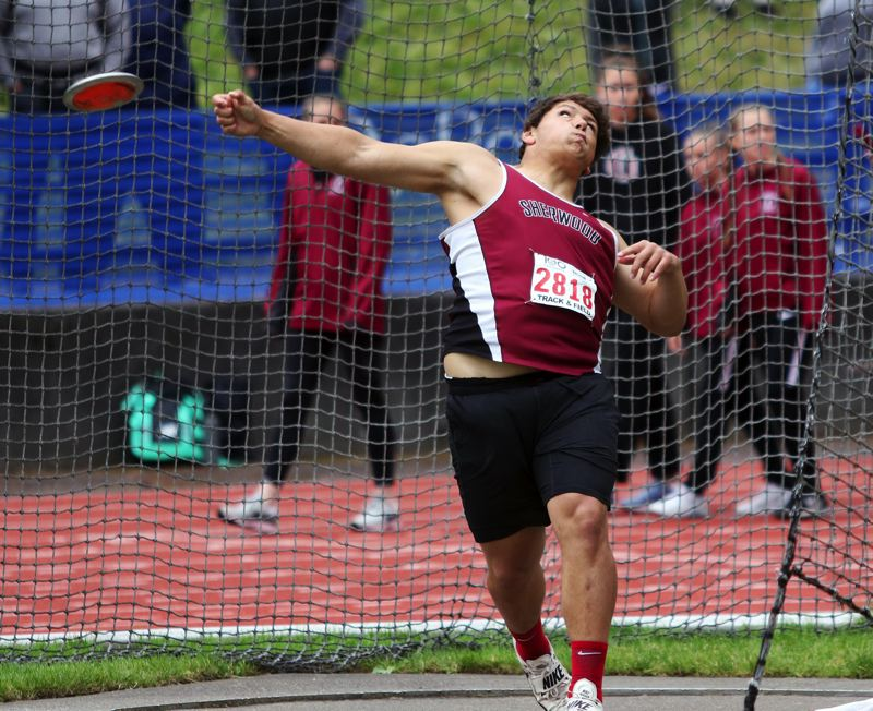 PMG PHOTO: DAN BROOD - Sherwood High School sophomore Bryan Cuthbertson took second place in the discus event at the Class 6A state track and field championships.