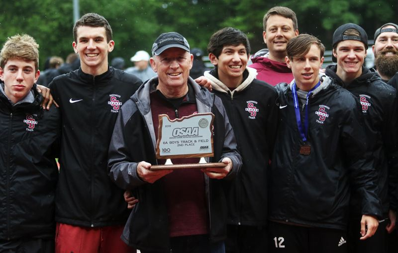 PMG PHOTO: DAN BROOD - Sherwood High School head coach Terrel Smith holds the second-place trophy following the Clss 6A state track and field championships.