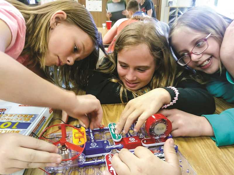 PHOTO COURTESY OF DALLAS ENDICOTT  - Children in the After the Bell program use circuit boards to learn about engineering. Pictured left to right, Delanie Sullivan, Cairo Wrolson and Lillyonna Johnson.
