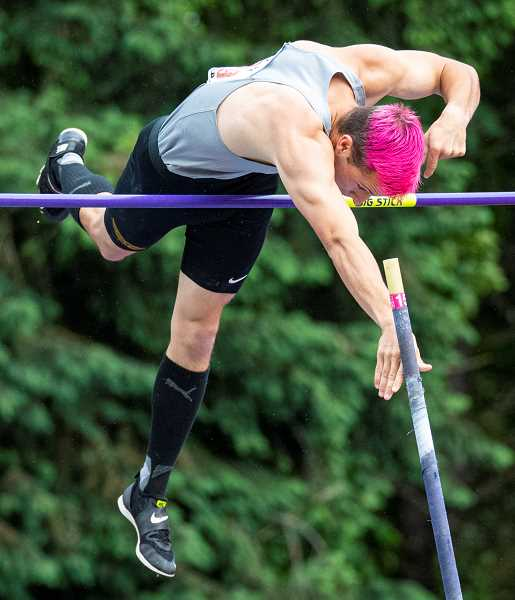 LON AUSTIN/CENTRAL OREGONIAN - Noah Chaney pushes off of his pole at the top of his jump at 14-00. Chaney cleared the bar to finish second in the meet. Cody Le Bel of Crater won the event with a clearance of 14-03.