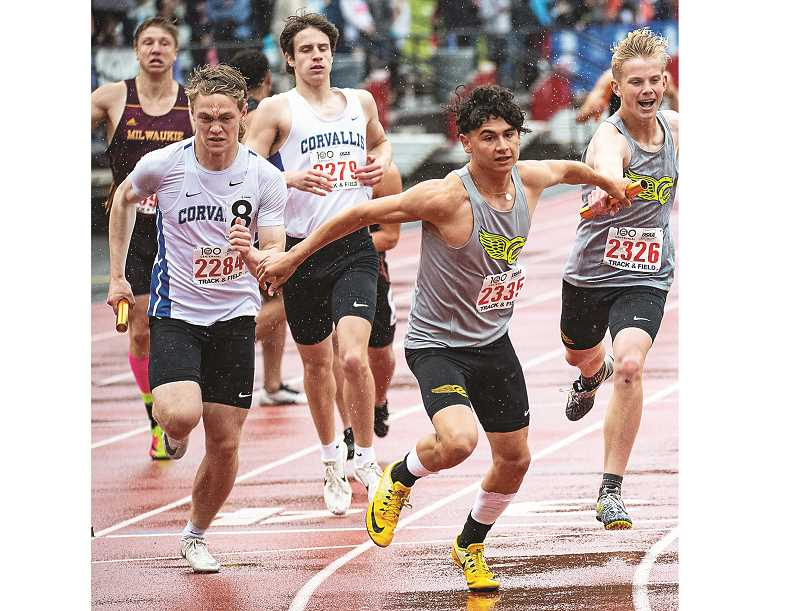 LON AUSTIN/CENTRAL OREGONIAN - Alec Carne passes the baton to Dominic Langley for the final leg of the 4x400-meter relay. The Cowboys went on to finish seventh in the race. Crook County placed fifth in the boys portion of the state meet and 10th in the girls scoring.