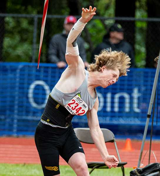 LON AUSTIN/CENTRAL OREGONIAN - Jason Slawter follows through after throwing the javelin at the state meet. Slawter finished in seventh place in the event.