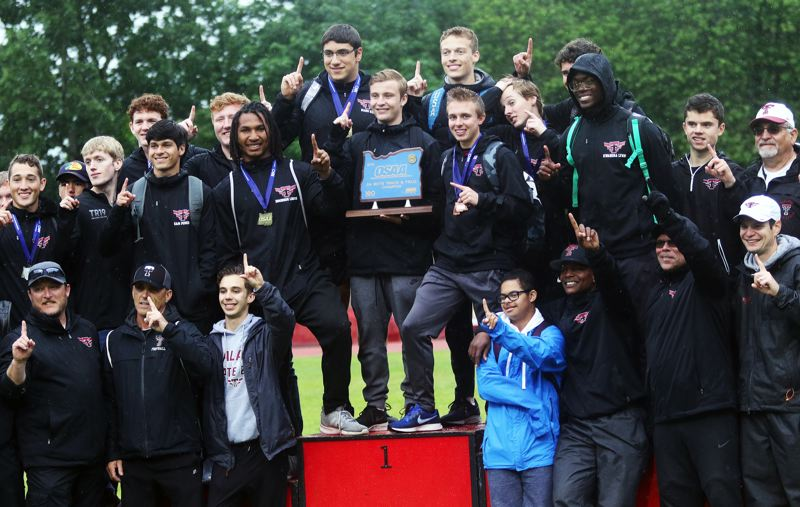 PMG PHOTO: DAN BROOD - The Tualatin High School boys track and field team won the school's first ever Class 6A state meet championship.