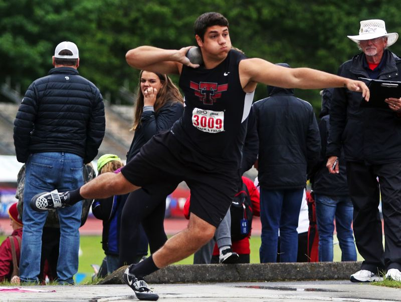 PMG PHOTO: DAN BROOD - Tualatin High School senior Nano Kis took first place in the shot put competition with a personal-best throw of 57 feet, 11 inches.