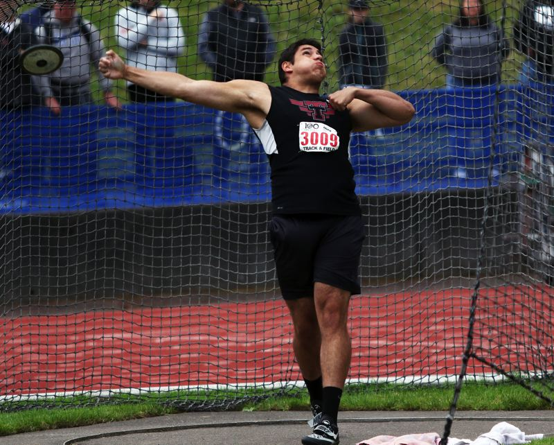 PMG PHOTO: DAN BROOD - Tualatin High School senior Nano Kis won his second straight state championship in the discus event with his throw of 177-7 on Saturday.