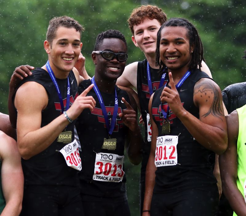 PMG PHOTO: DAN BROOD - Tualatin's (from left) Luke Marion, Kwabena Lynn, Andrew McDade and Dominique Loggins teamed to win the 4 x 100 relay event at the Class 6A state track and field championships.
