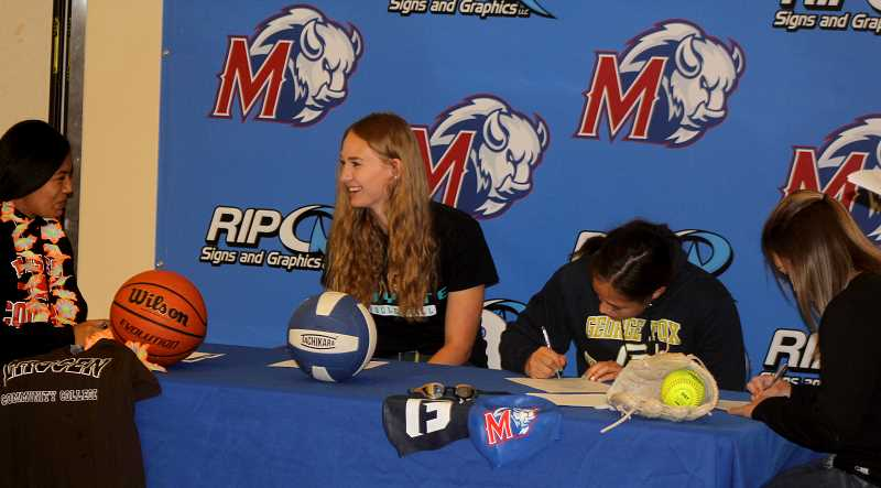 STEELE HAUGEN - Left to right Jackie Zamora-Heath signs her letter of intent to play basketball at Lassen Community College in Susanville, California. Alley Dominiak commits to playing volleyball at Chandler Gilbert Community College in Arizona. Gabi Smith will be attending George Fox University next year for swimming and Lizzie Steuart commits to Mt. Hood Community College to play softball. Ten athletes signed their letters of intent in front of the entire school during the lunch hour.