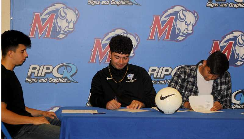 STEELE HAUGEN - Left to right, Melchor Olivera, Andres Acuna and Esteban Gomez all committed to playing soccer at Blue Mountain Community College.