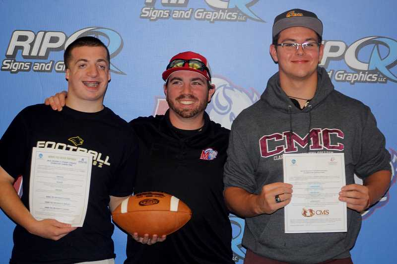 STEELE HAUGEN - Kaegan Prevett (left) and Kobey Jorgensen (right) are with head football coach Kurt Taylor after committing to play college football. Prevett committed to playing football at George Fox University, while Jorgensen is taking his talents to Claremont McKenna College, a private liberal arts school in Claremont, California.
