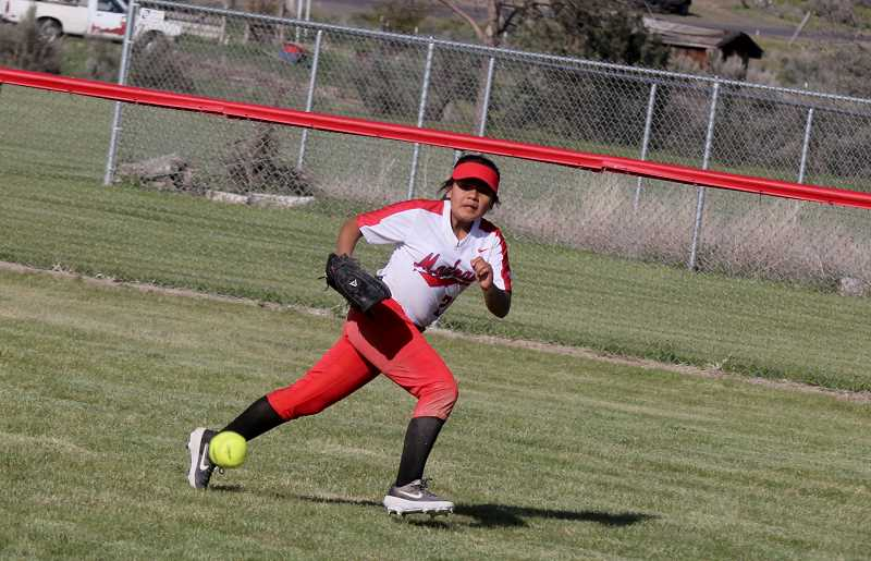 STEELE HAUGEN - Freshman Marilyn Tom chases after a ball in this file photo. Tom had a great season as a freshman, having the second best batting average on the team. She will be a crucial part in the success of next year's team.