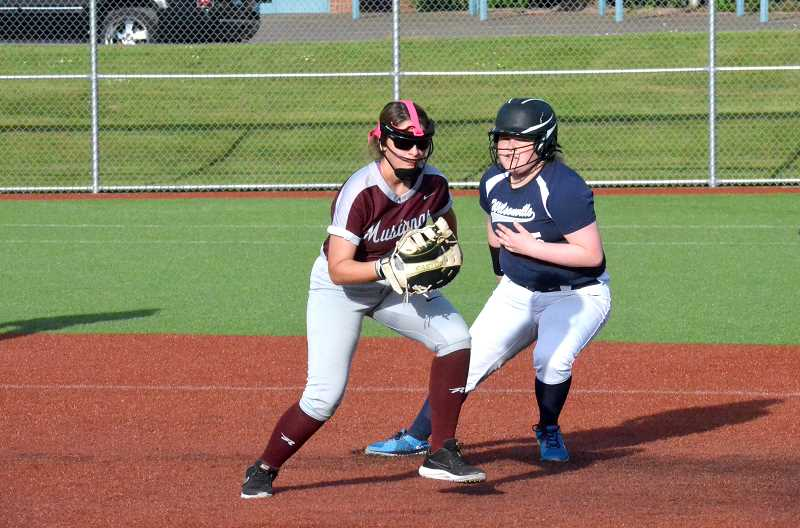 PMG FILE PHOTO: TANNER RUSS - Wilsonvilles Rhiannon Torango heads back to first base against Milwaukie.